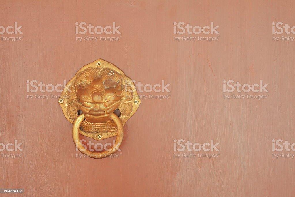 Brass knocker on red doors. stock photo