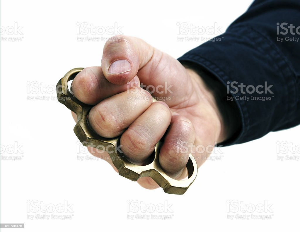 Brass knuckle fist stock photo