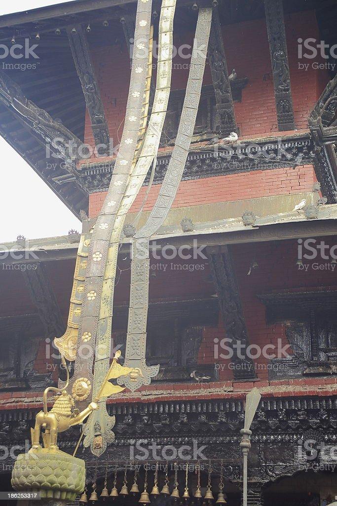 Brass lion facing the Manakamana Mandir-Nepal. 0348 stock photo