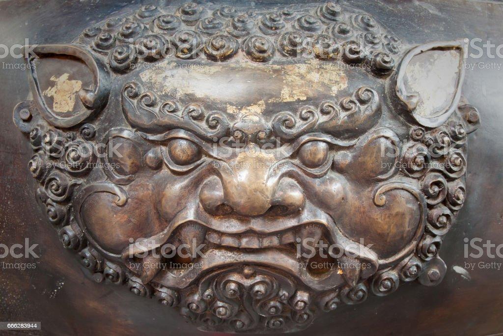 Brass lion head sculpture in thai temple stock photo