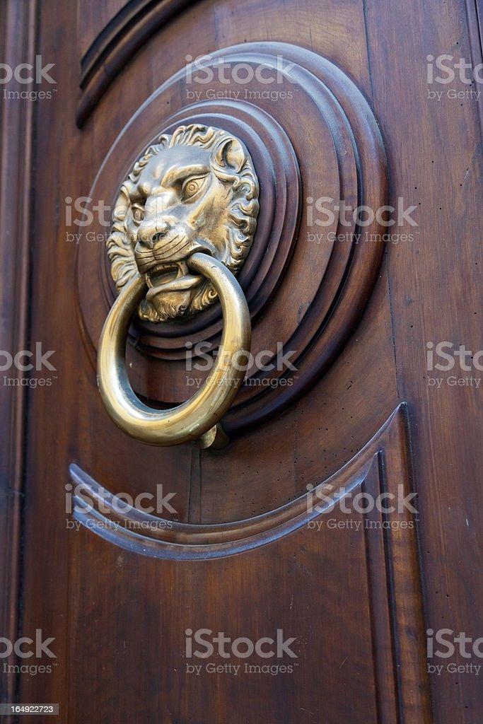brass lion head shaped door handle royalty-free stock photo