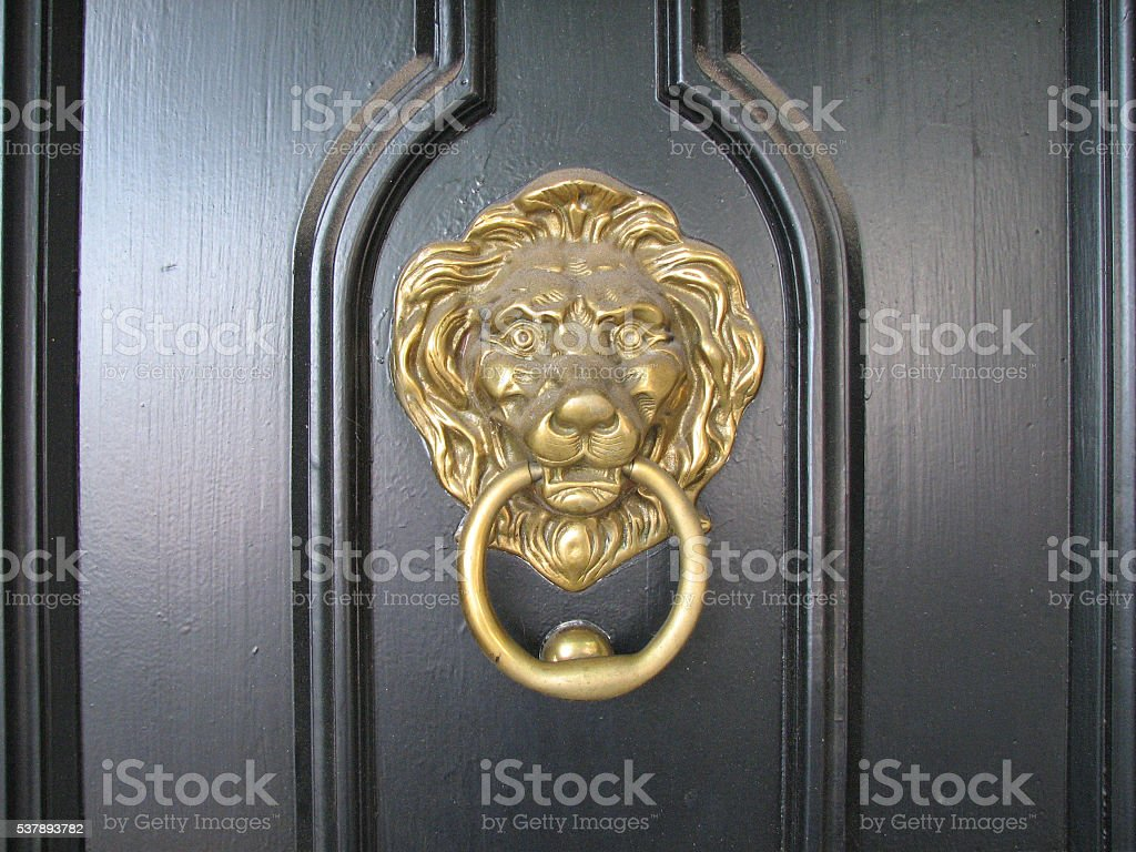 Brass Lionhead Doorknocker stock photo