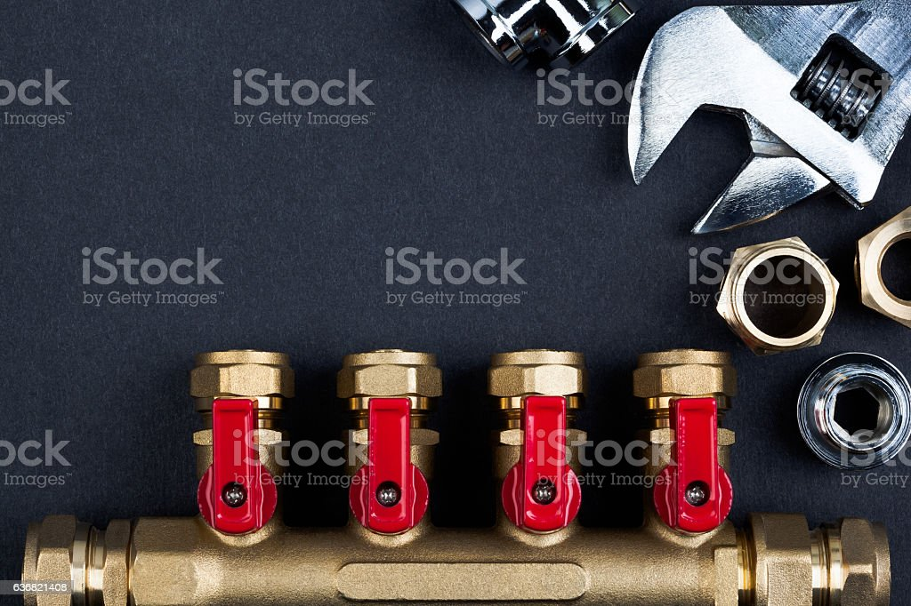 Brass manifold valve and wrench. stock photo