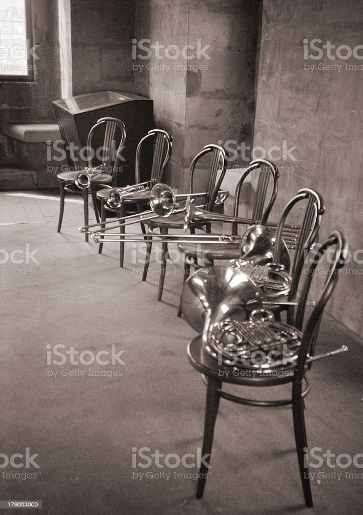 Brass Musical Instruments on Chairs stock photo
