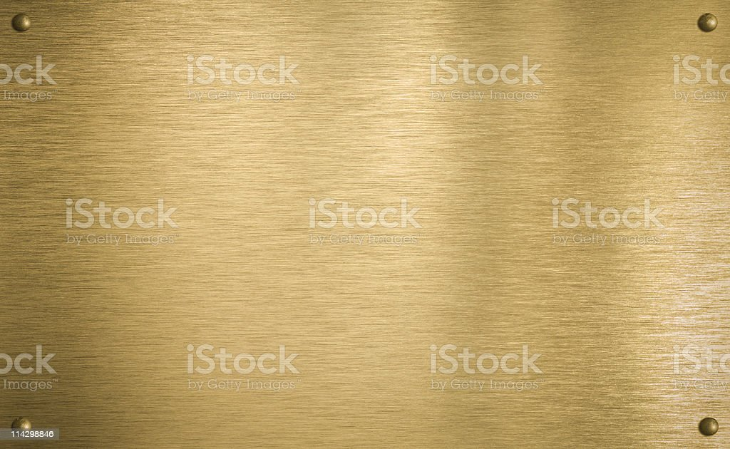 Brass or gold metal plate with four rivets stock photo