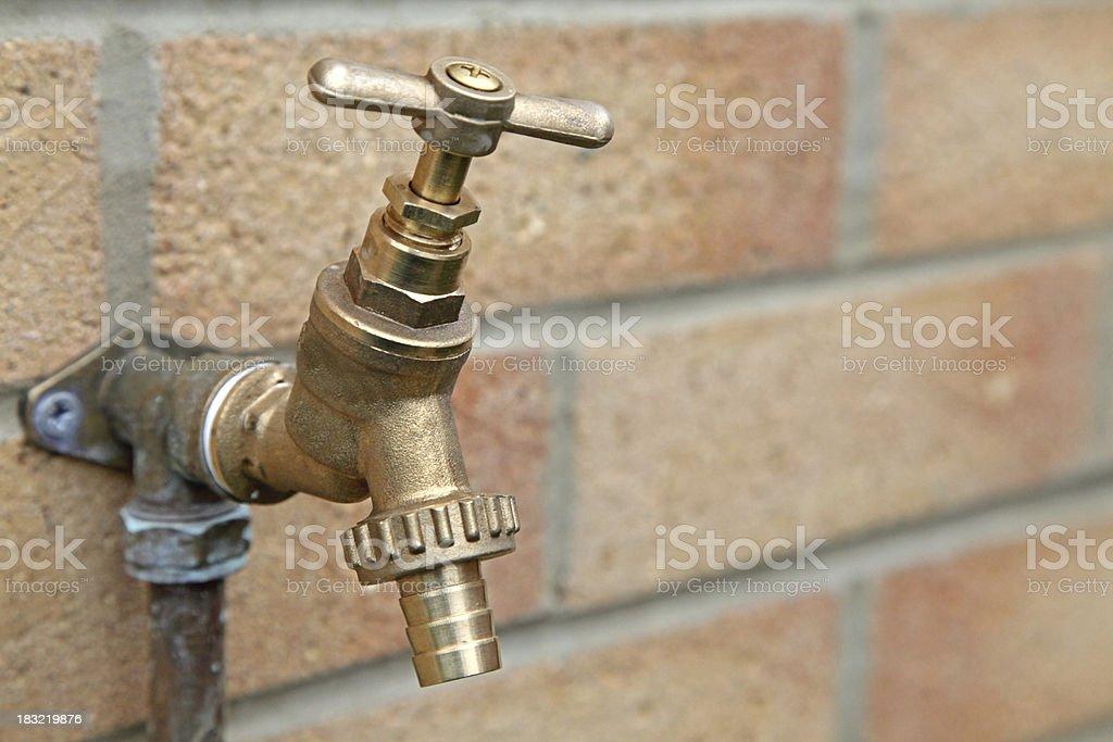 brass outside tap stock photo