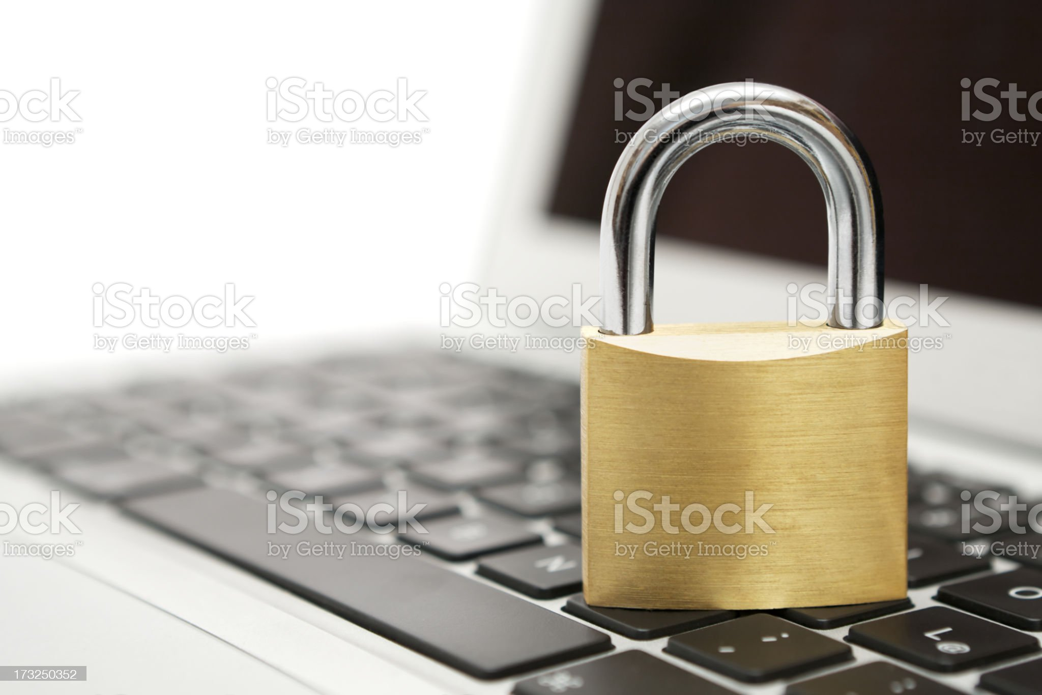 Brass Padlock on Laptop royalty-free stock photo