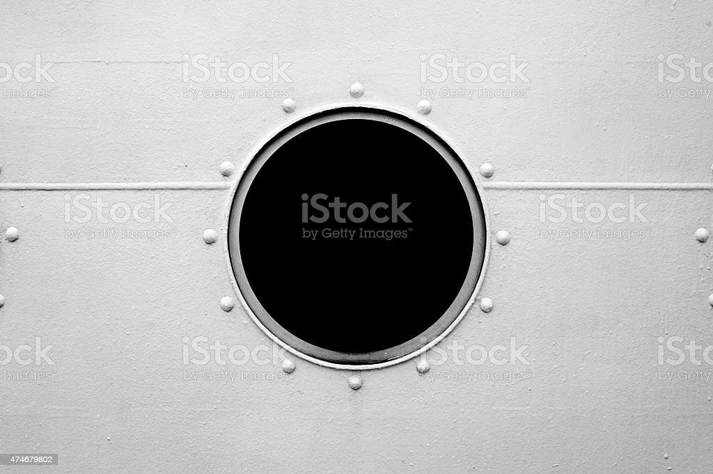 Brass porthole, ferry window frame stock photo