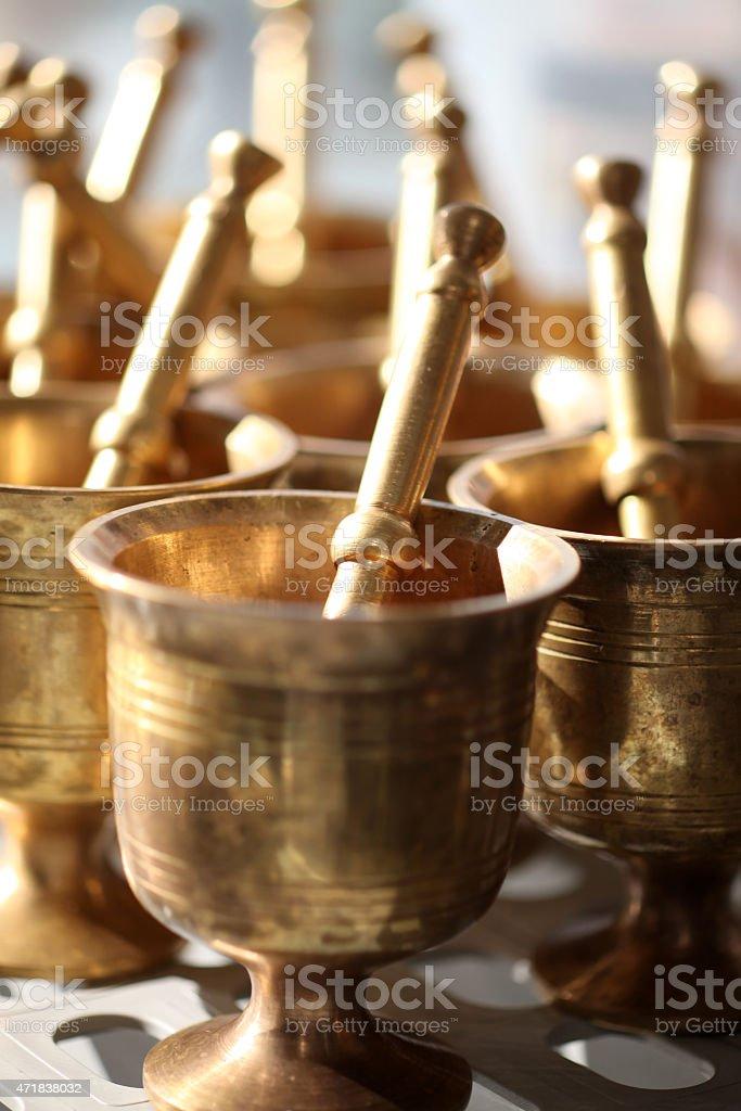 Brass pounders stock photo