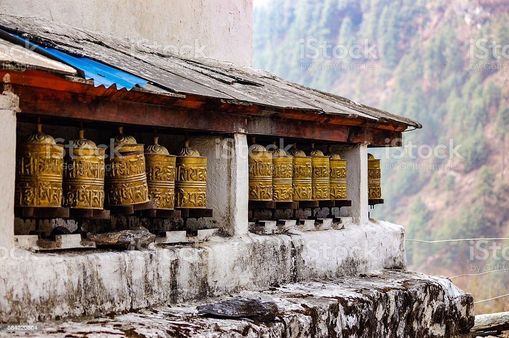 Brass prayer wheels with hazy background stock photo