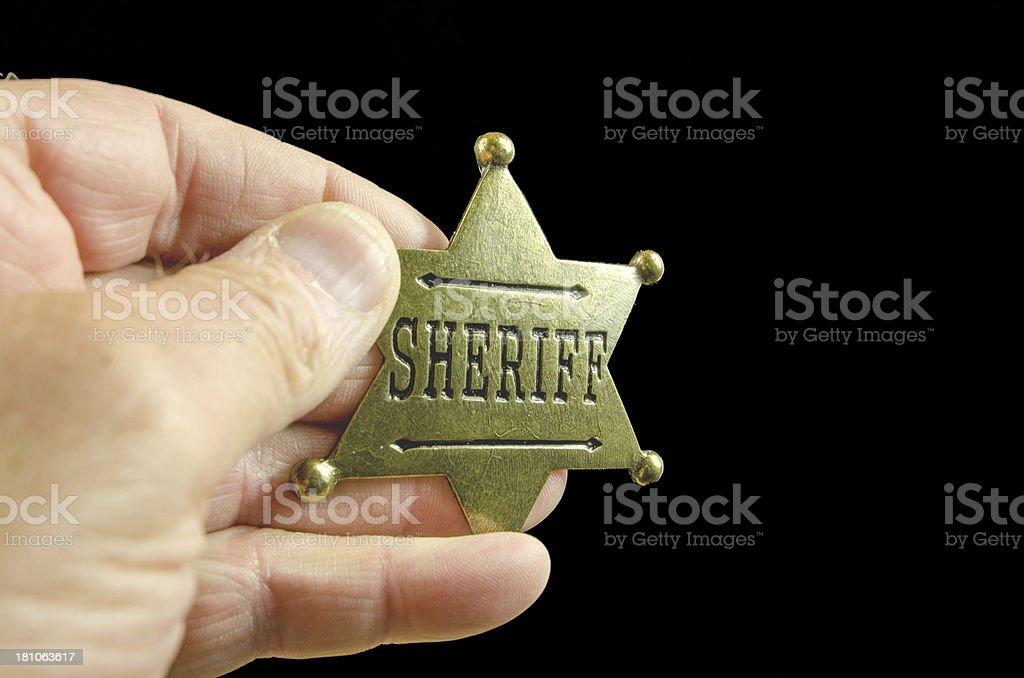 Brass Sheriff Badge Hand-Held royalty-free stock photo