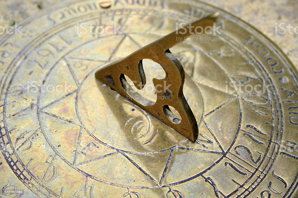 brass sundial stock photo