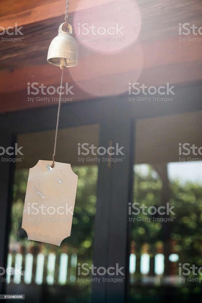 Brass wind chime in the garden stock photo