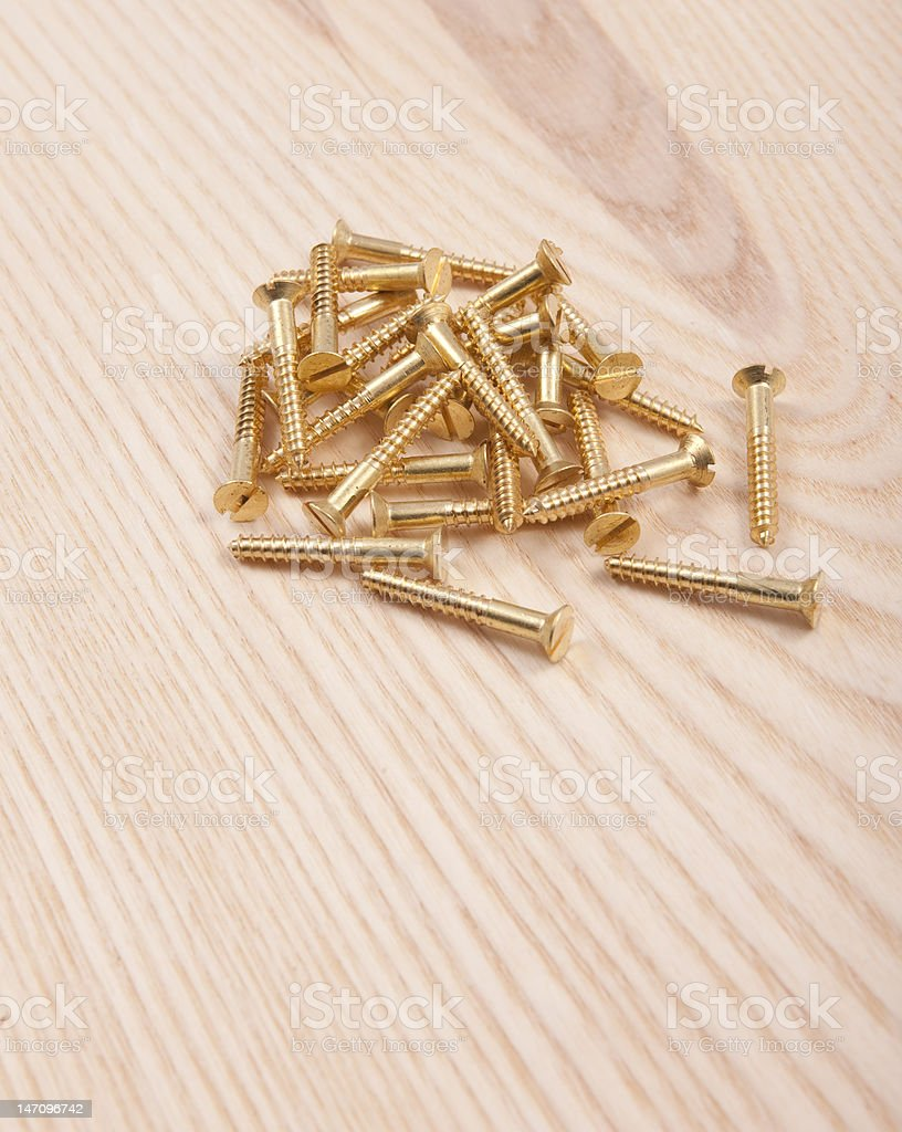 Brass wood screws on ash plank stock photo