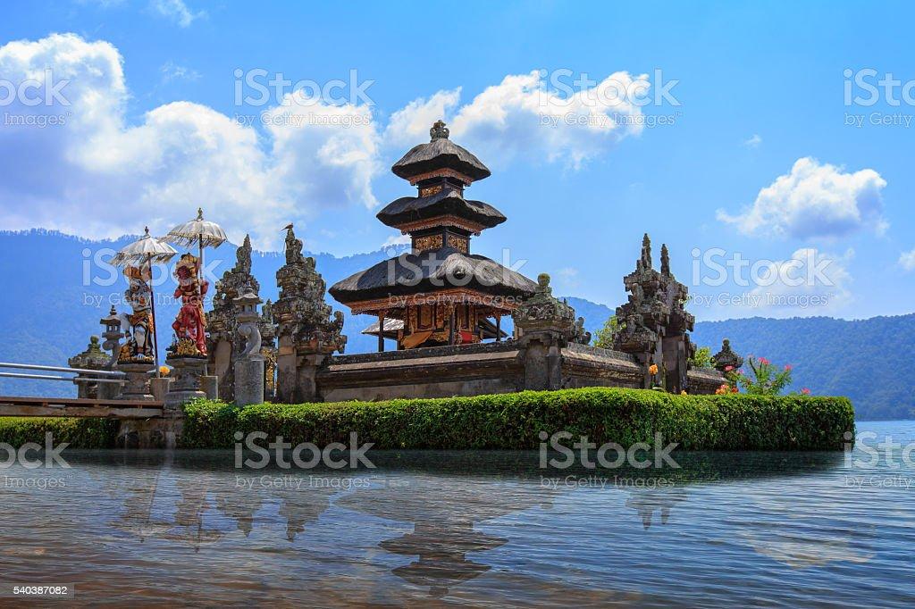 Bratan temple in lake on sunshine and blue sky stock photo