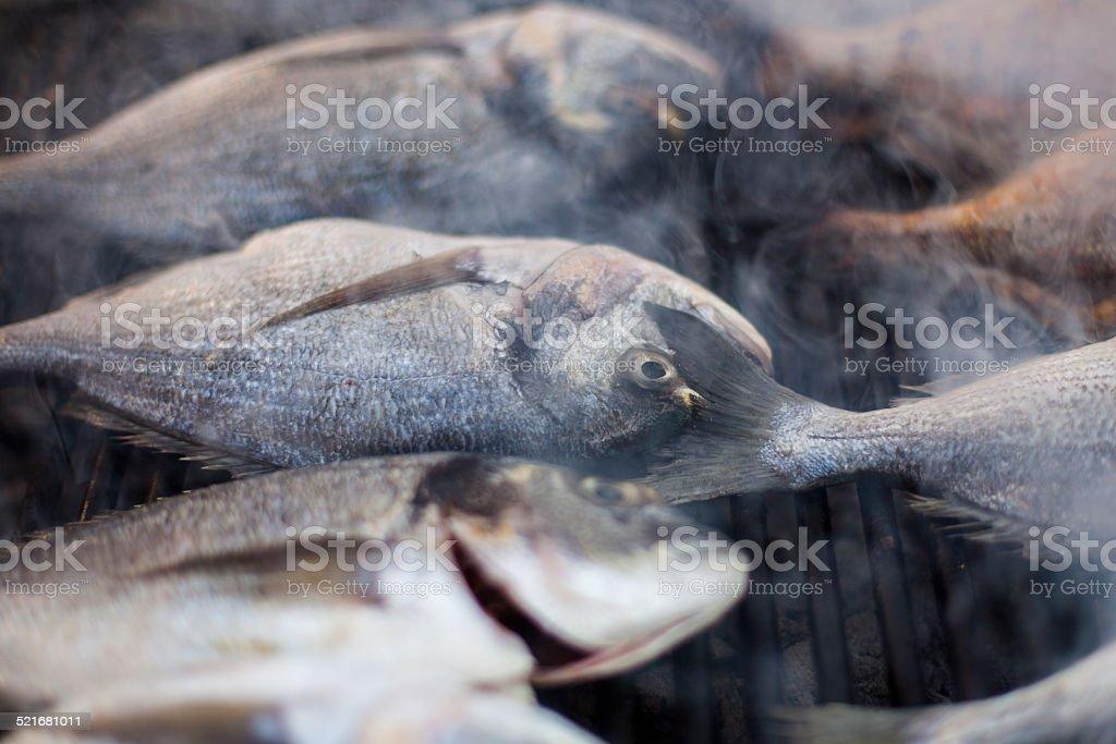 Bratfisch - fish on the grill stock photo