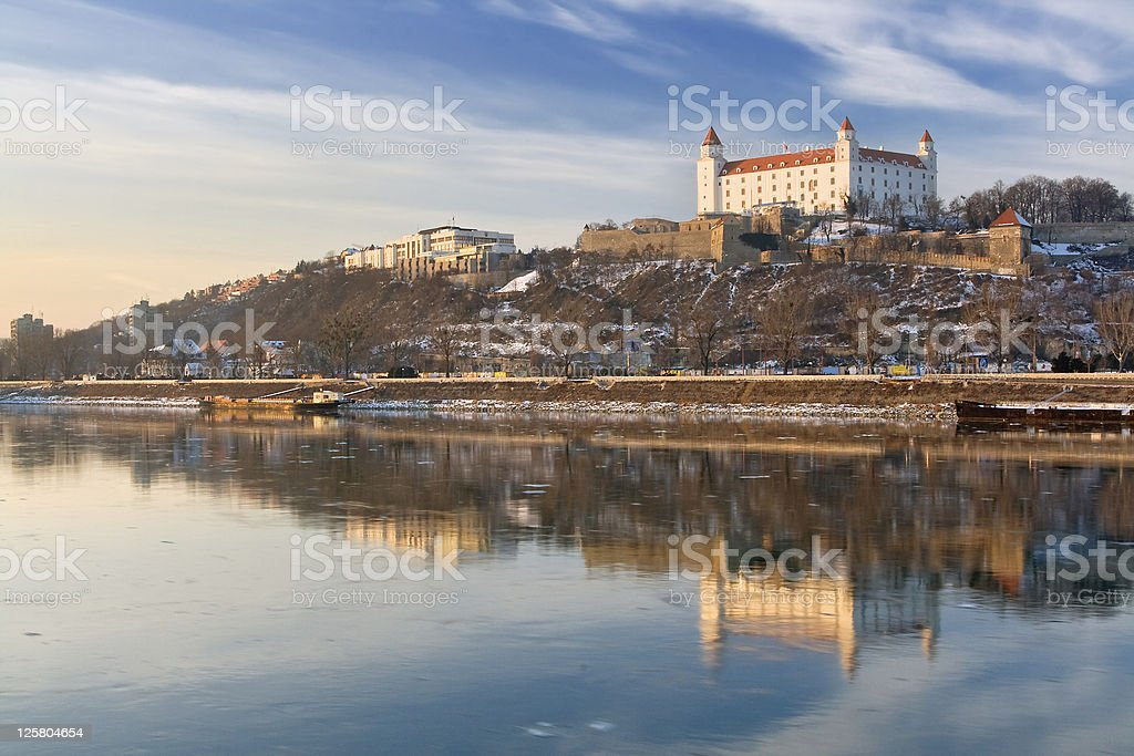 Bratislava Castle and surroundings as seen from the water stock photo