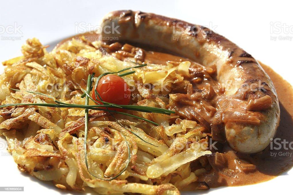 Bratwurst and potato rosti - classic Swiss dinner royalty-free stock photo