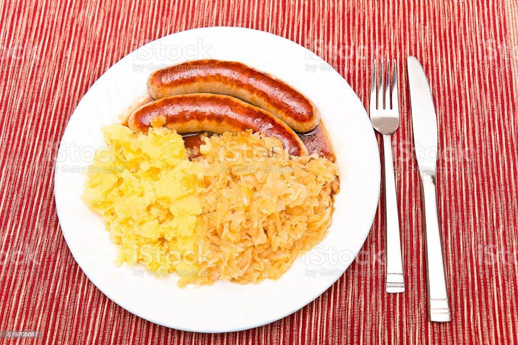 Bratwurst with Sauerkraut and Mashed Potatoes stock photo