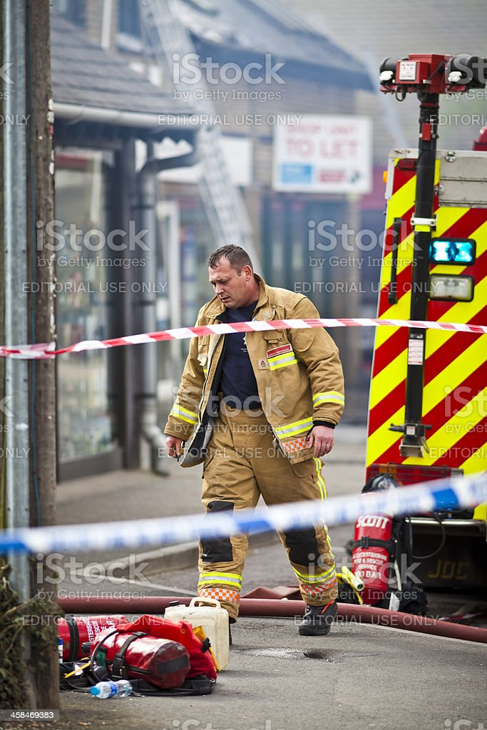 Brave and tired fireman after fighting fires royalty-free stock photo