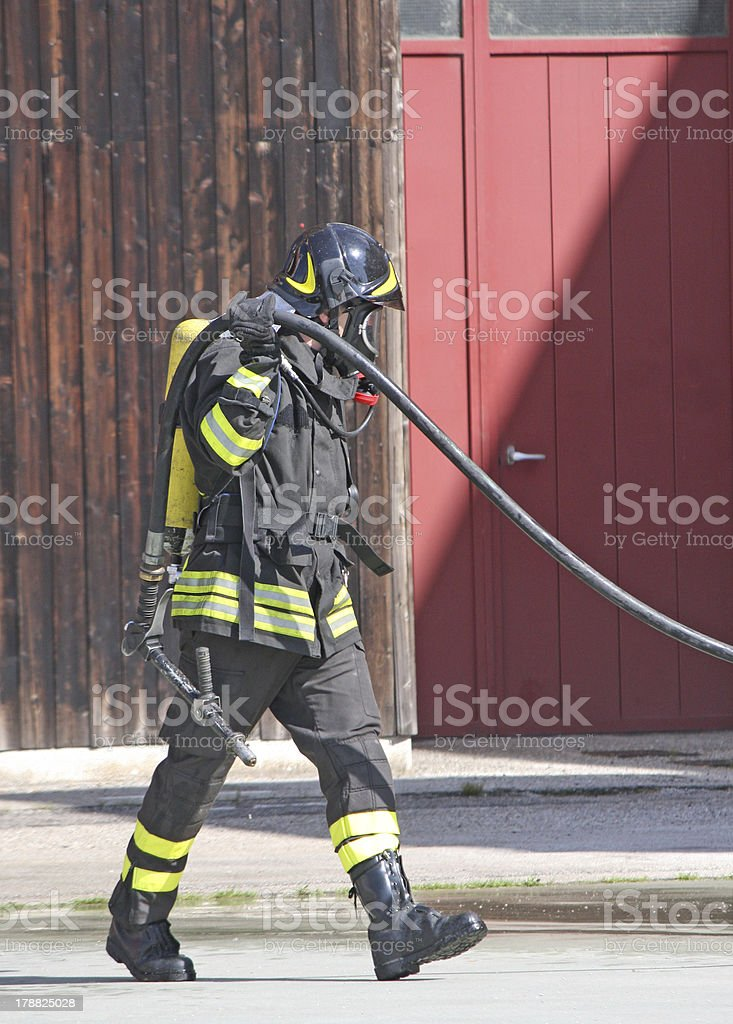 brave firefighters with oxygen tank fire during an exercise held royalty-free stock photo