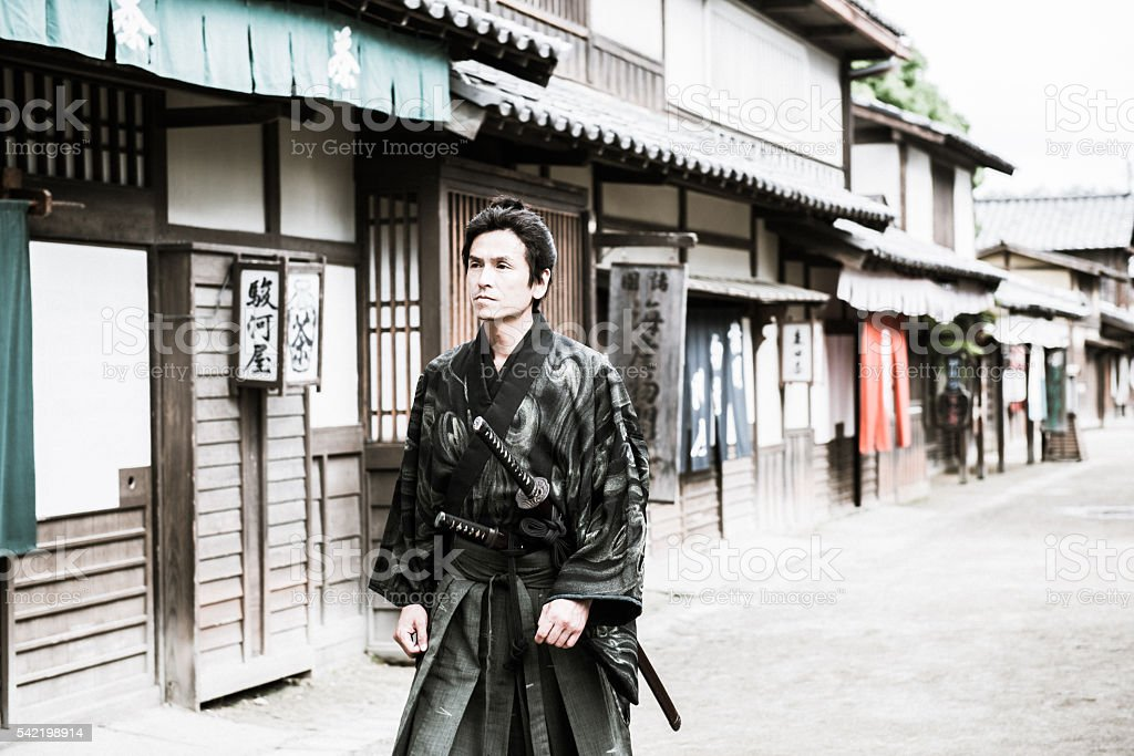 Brave Japanese Samurai Warrior Protecting Old Town, Edo period, Kyoto stock photo