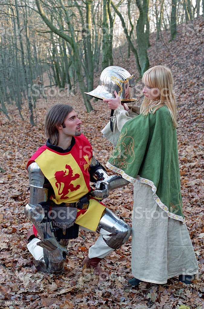 brave knight and maid in forest royalty-free stock photo