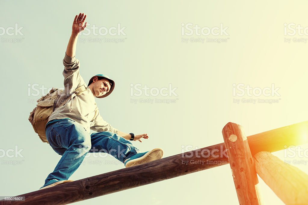 brave man balancing stock photo