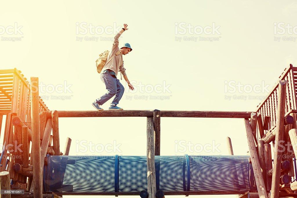 brave man balancing stock photo