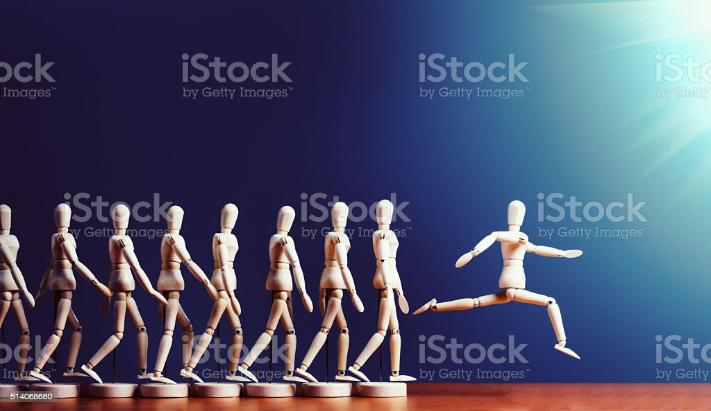 Brave puppet breaks away from pack, leaping into spotlight stock photo