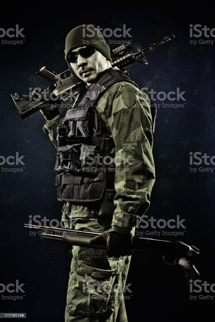 Brave Soldier posing with weapons studio shoot stock photo