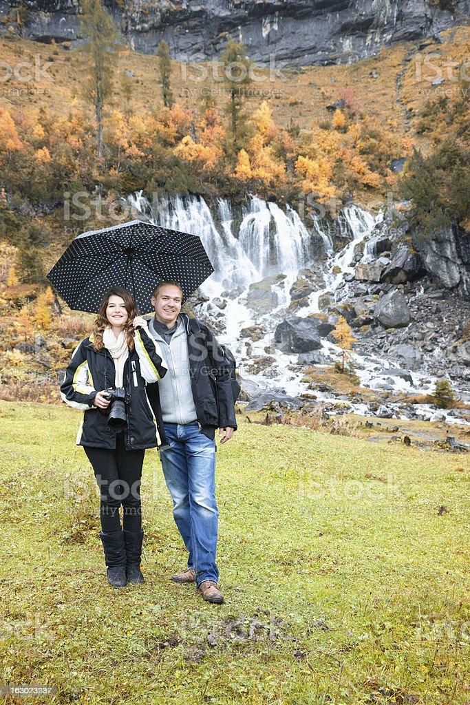 Brave tourist couple visit Switzerland on rainy day royalty-free stock photo