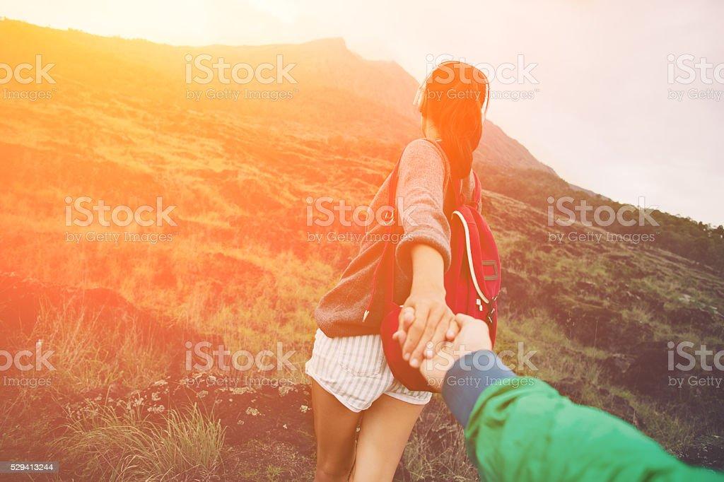 Brave woman guiding man into the wild stock photo