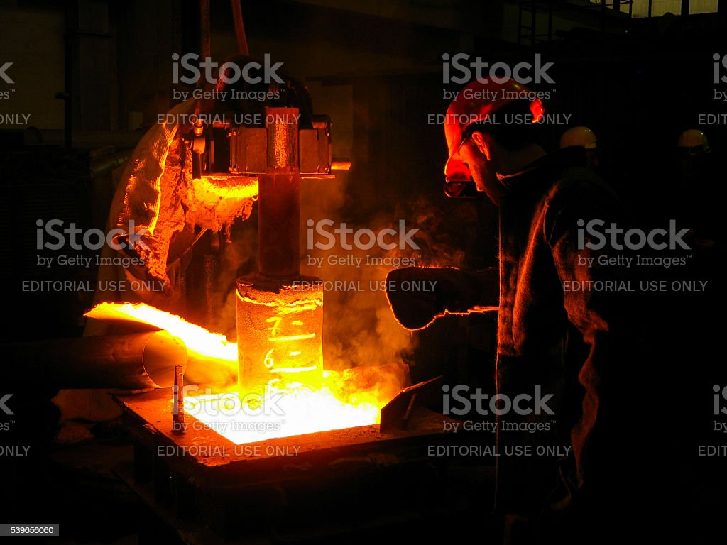 Brave Worker in Metallurgical Plant stock photo