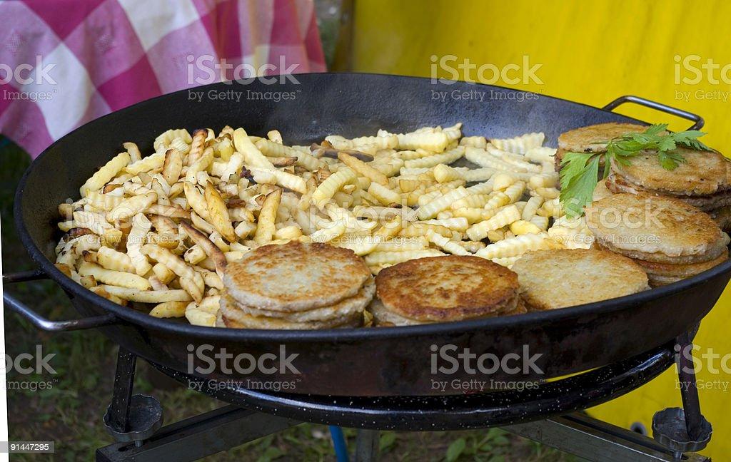 Brazier with a preparing potato royalty-free stock photo