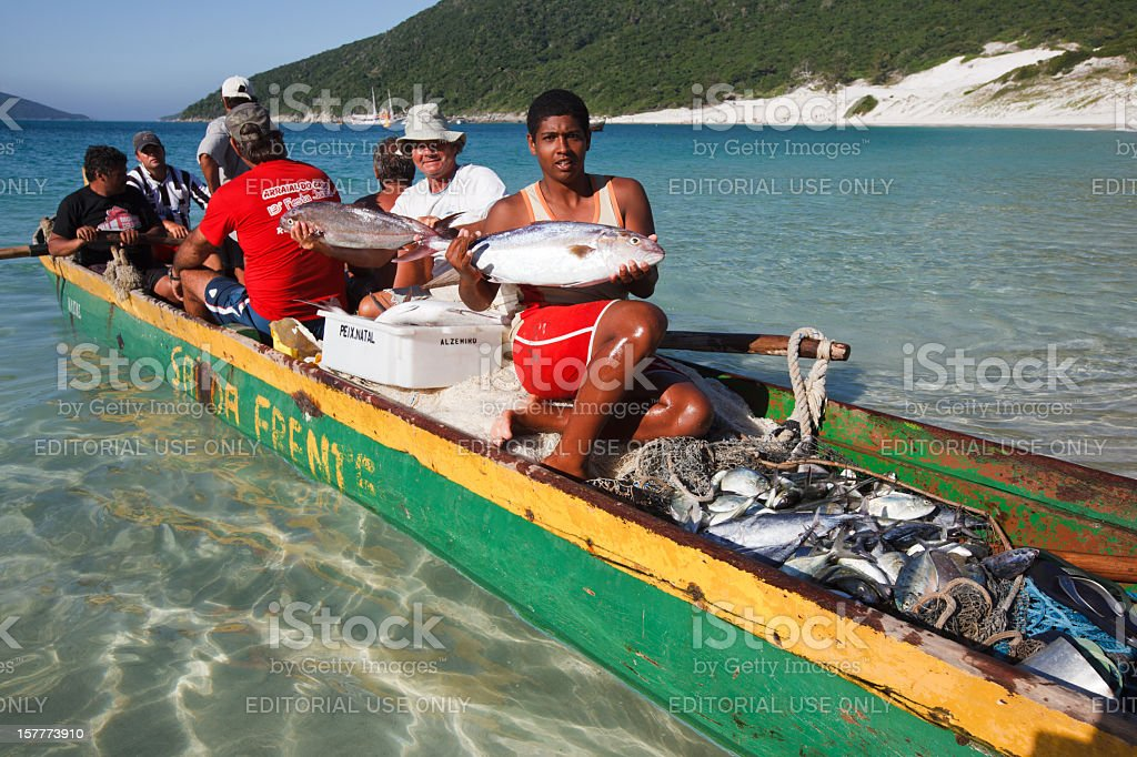 Brazil. Fishermen on a Boat Loaded with Fish stock photo