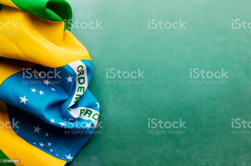 Brazil flag against chalkboard background stock photo
