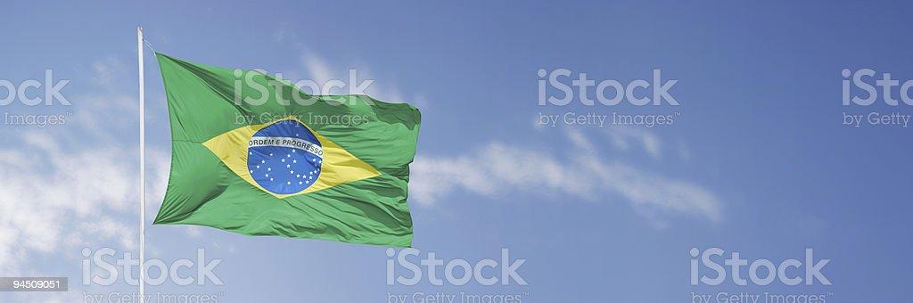 Brazil flag over blue sky stock photo