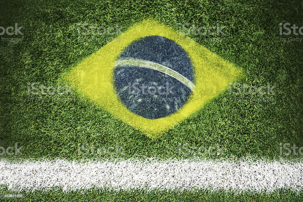 Brazil flag printed on a soccer field royalty-free stock photo