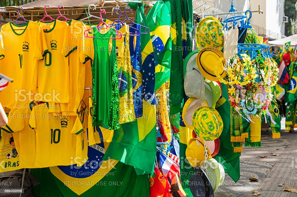 Brazil flags, cornets, hats and shirts for sale stock photo