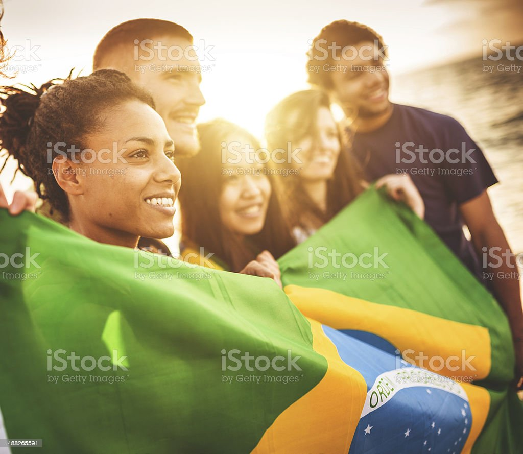 brazil supporter cheering togetherness at the beach soccer match stock photo