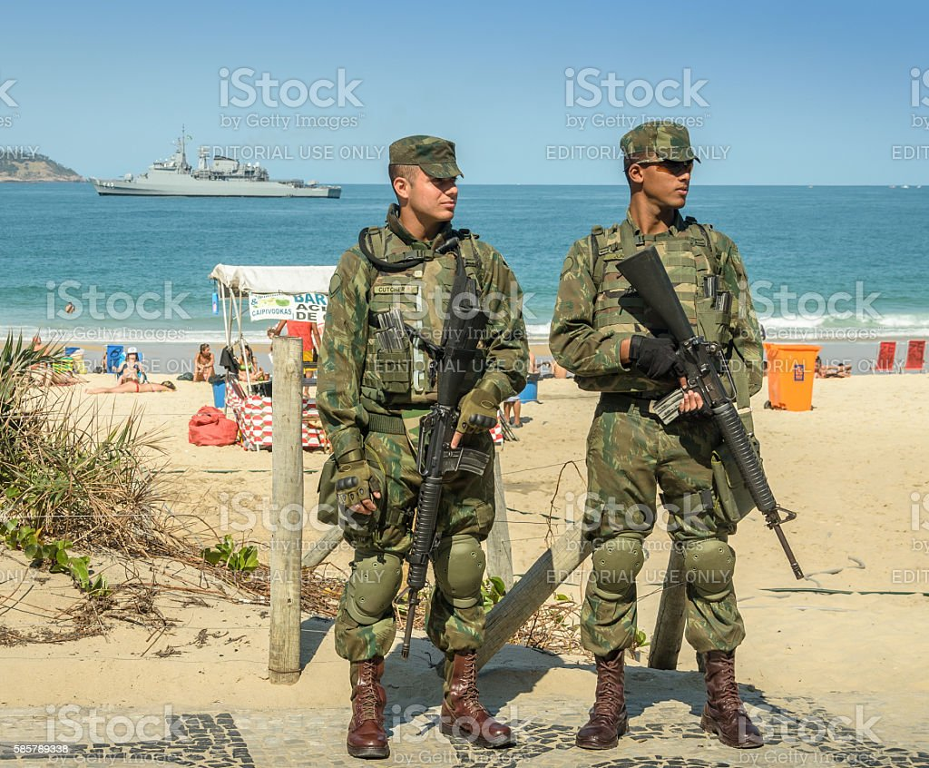 Brazilian army watch over tourists during Olympics stock photo