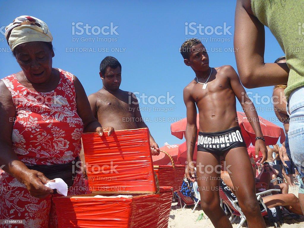 Brazilian Beach Vendor with Customers Ipanema Rio de Janeiro stock photo
