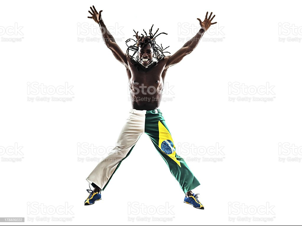 Brazilian black man jumping arms outstretched royalty-free stock photo