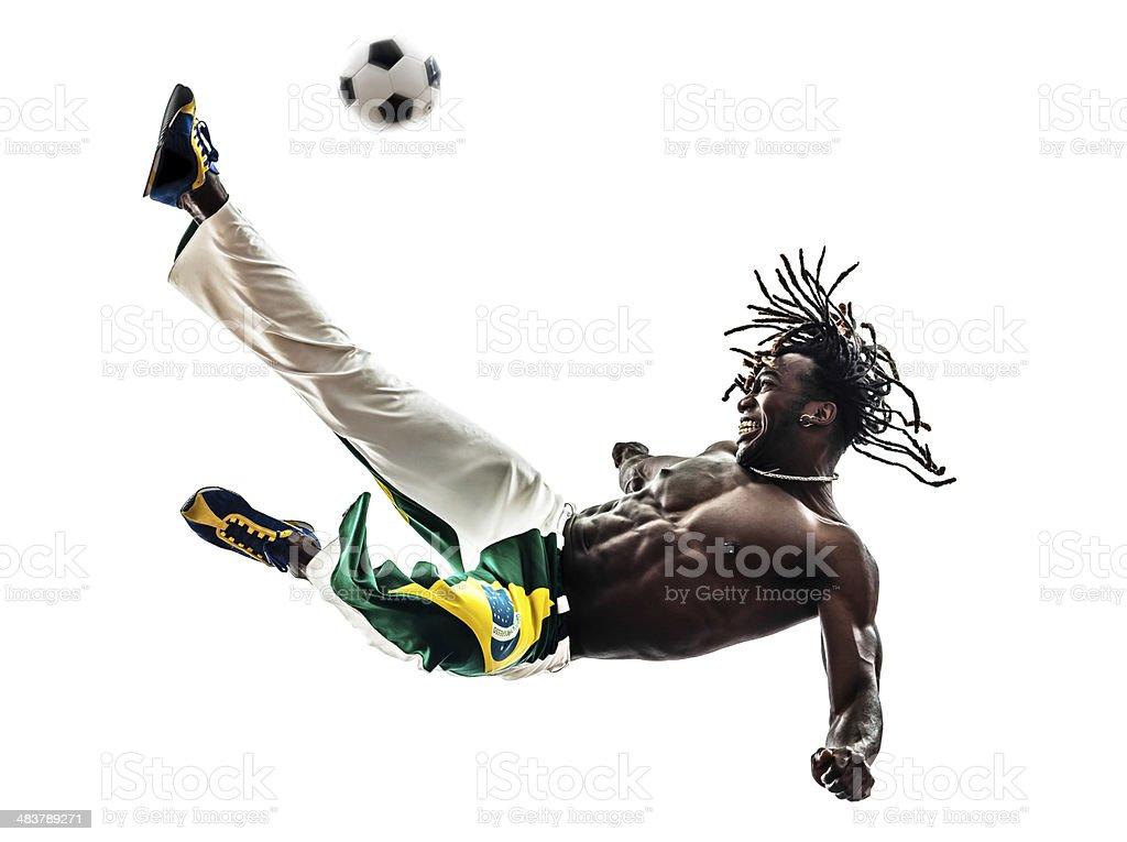 Brazilian black man soccer player kicking football royalty-free stock photo