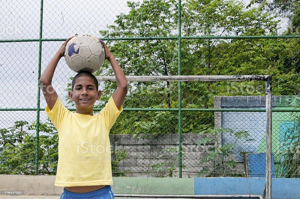 Brazilian boy smiling with a soccer ball, Rio de Janeiro royalty-free stock photo