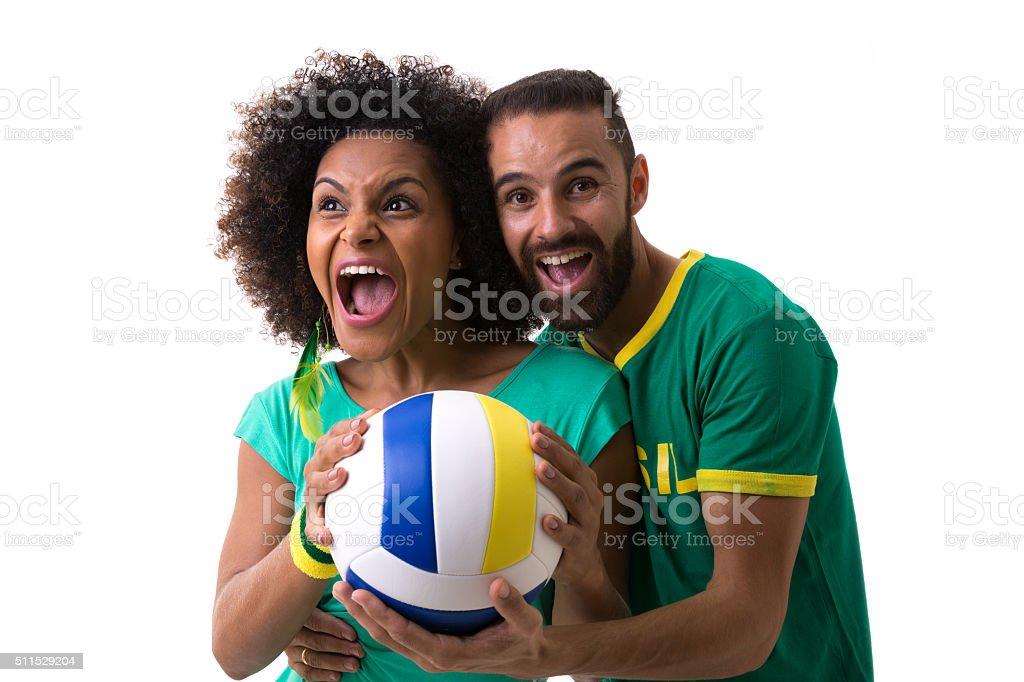 Brazilian couple of fans celebrating on white background stock photo