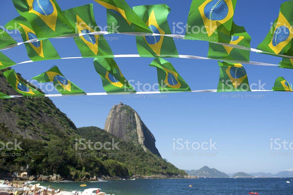 Brazilian Flag Bunting Red Beach Sugarloaf Rio Brazil stock photo