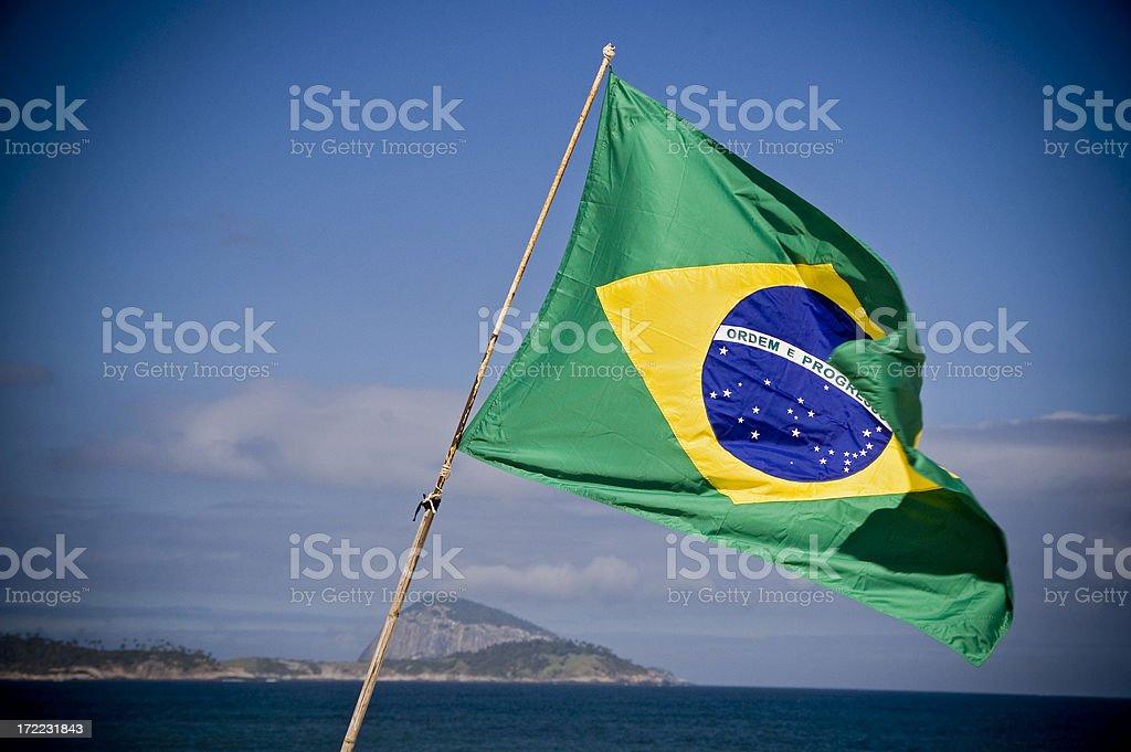Brazilian flag waving in the wind stock photo