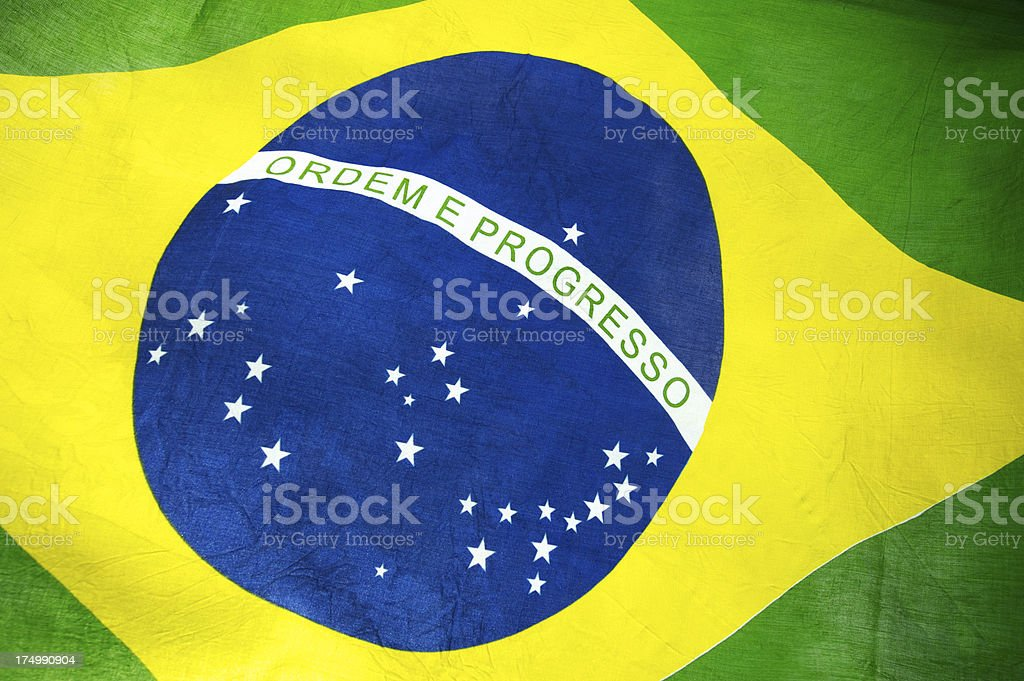 Brazilian Flag with Sunlight Behind Textured Fabric royalty-free stock photo